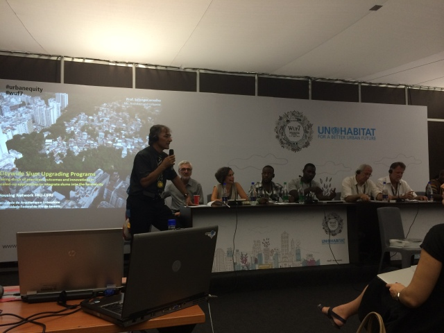 Claudio Acioly moderating a panel on slum upgrading programs in Brazil, South Africa, and Kenya