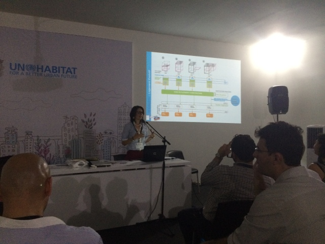 Adriana Navarro-Sertich (UNOPS) speaking on how to build more than a roof