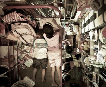 "Two generations of Hong Kong resident in a typically sized ""home"" for the working class."